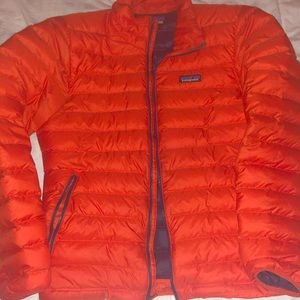 Bright orange men's down Patagonia jacket
